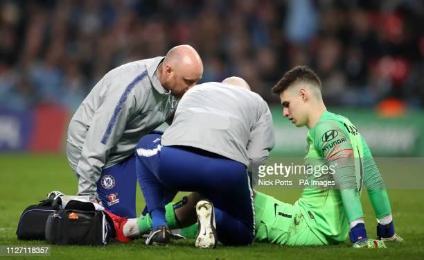 Chelsea goalkeeper Kepa Arrizabalaga receives medical treatment during the Carabao Cup Final at Wembley Stadium London