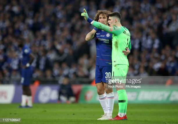 Chelsea goalkeeper Kepa Arrizabalaga refuses to leave the pitch after his proposed substitution during the Carabao Cup Final at Wembley Stadium London