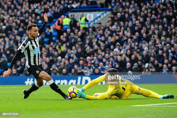 Chelsea Goalkeeper Thibaut Courtois dives to make a save from Jacob Murphy of Newcastle United during the Premier League match between Chelsea and...