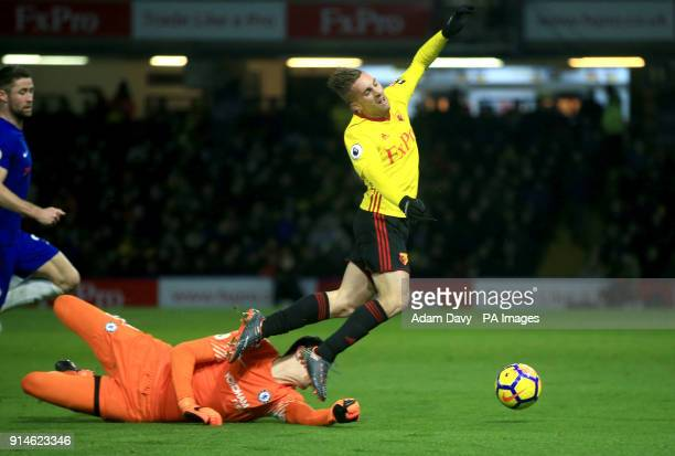 Chelsea goalkeeper Thibaut Courtois fouls Watford's Gerard Deulofeu to concede a penalty during the Premier League match at Vicarage Road Watford