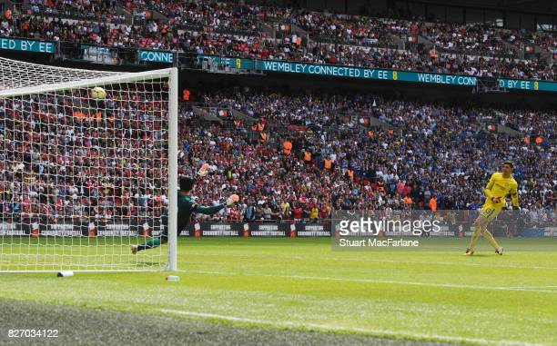 Chelsea goalkeeper Thibaut Courtois misses his penalty during the shoot out during the FA Community Shield match between Chelsea and Arsenal at...
