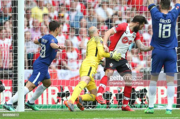 Chelsea goalkeeper Willy Caballero appears to take the ball across the line but the goal is disallowed due to a foul by Charlie Austin of Southampton...
