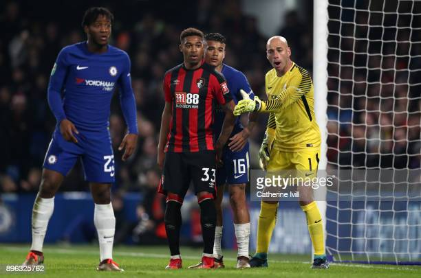 Chelsea goalkeeper Willy Caballero in action with Jordon Ibe of AFC Bournemouth and Kenedy of Chelsea during the Carabao Cup QuarterFinal match...