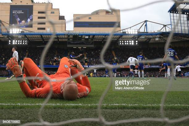 Chelsea goalkeeper Willy Caballero reacts after he is beaten by a long range goal from Christian Eriksen of Tottenham Hotspur during the Premier...