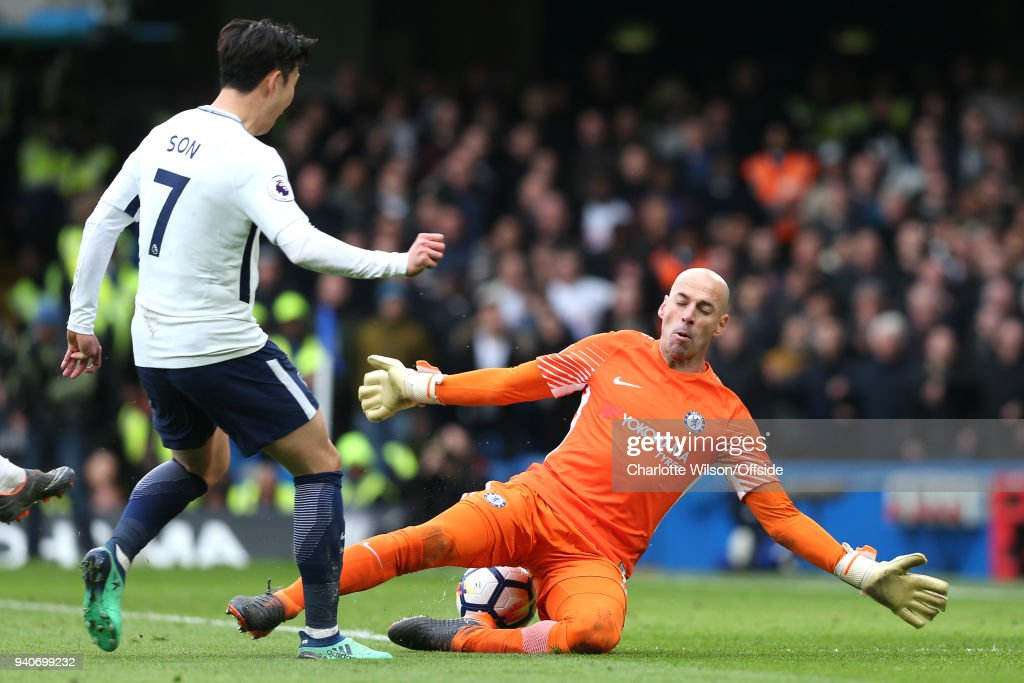 Chelsea goalkeeper Willy Caballero saves the shot of Heung-Min Son of Tottenham during the Premier League match between Chelsea and Tottenham Hotspur at Stamford Bridge on April 1, 2018 in London, England.