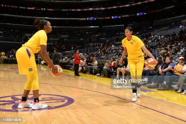 Chelsea Gray and Candace Parker of the Los Angeles Sparks warms up before the game against the Chicago Sky on June 30 2019 at the Staples Center in...