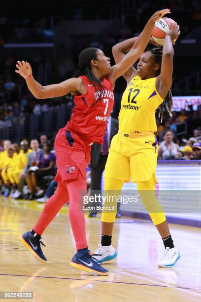 Chelsea Gray of the Los Angeles Sparks handles the ball against Ariel Atkins of the Washington Mystics during a WNBA basketball game at Staples...