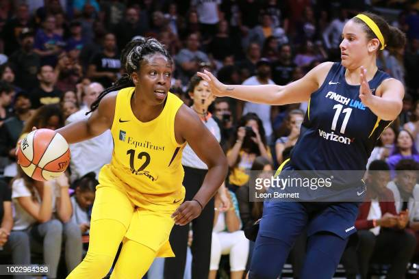 Chelsea Gray of the Los Angeles Sparks handles the ball against Natalie Achonwa of the Indiana Fever during a WNBA basketball game at Staples Center...