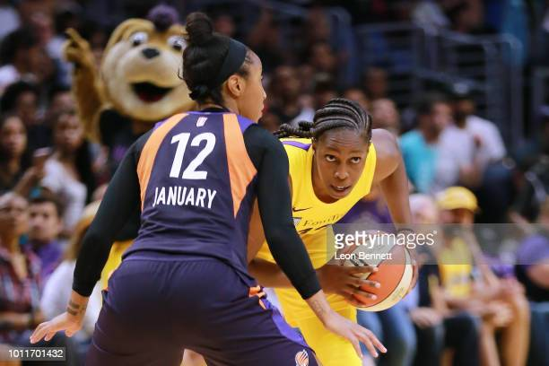 Chelsea Gray of the Los Angeles Sparks handles the ball against Briann January of the Phoenix Mercury during a WNBA basketball game at Staples Center...