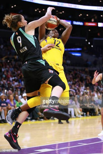 Chelsea Gray of the Los Angeles Sparks handles the ball against Rebecca Allen of the New York Liberty during a WNBA basketball game at Staples Center...