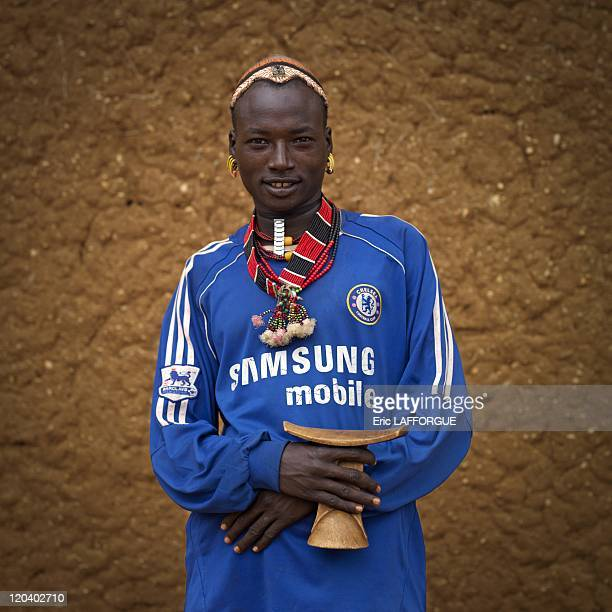 Chelsea Hamar fan in Turmi Omo valley Ethiopia on October 27 2008 Hamar in Turmi Ethiopia He wears a Chelsea shirt because all the men who can acess...
