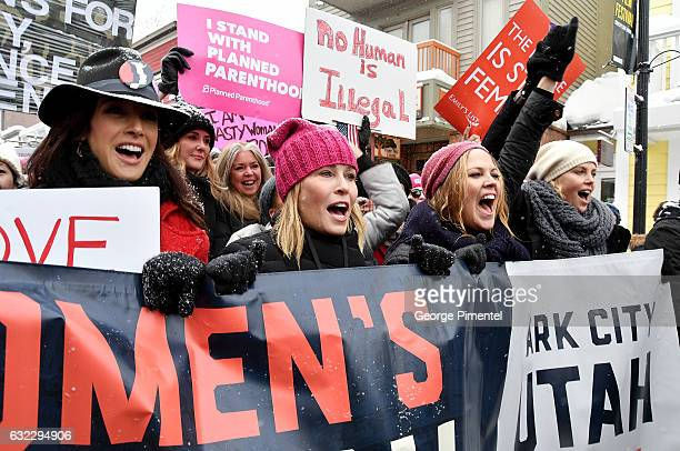 Chelsea Handler and Charlize Theron participates in the Women's March on Main Street Park City on January 21 2017 in Park City Utah