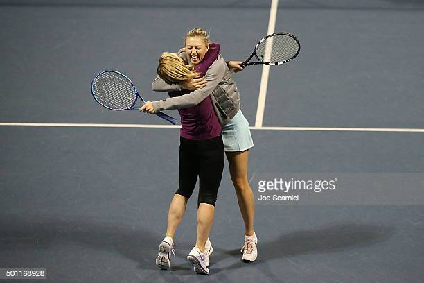 Chelsea Handler and Maria Sharapova celebrate a point at the Maria Sharapova and Friends tennis exhibition Presented By Porsche on December 12 2015...