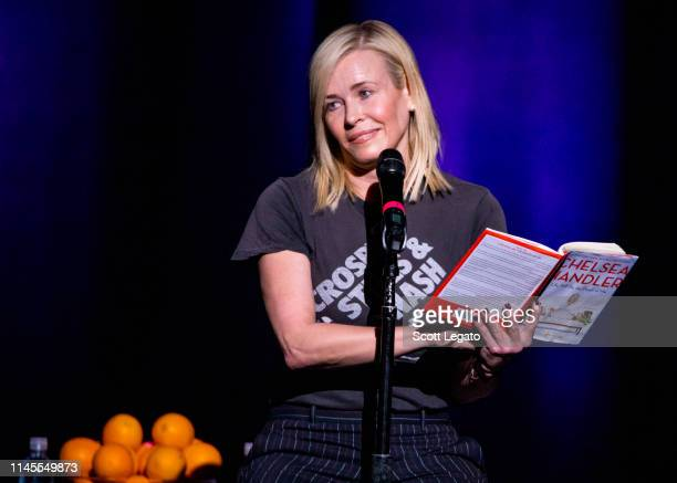 Chelsea Handler reads from her book Life Will Be the Death of Me while performing at The Fillmore Detroit on April 27 2019 in Detroit Michigan