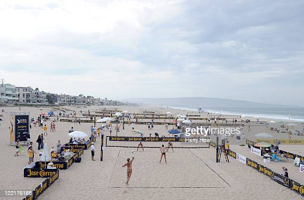 Chelsea Hayes and Mariko Coverdale serve to Tealle Hunkus and Heather Lowe in a first round match during the Manhattan Beach Open at Manhattan Beach...