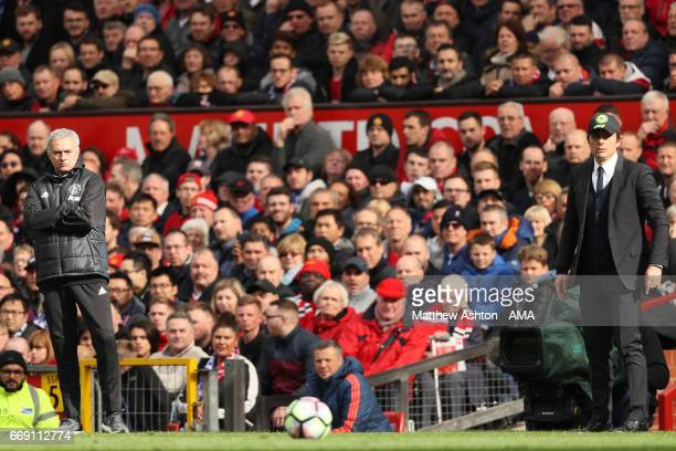 Chelsea Head Coach / Manager Antonio Conte and Manchester United Head Coach / Manager Jose Mourinho look on during the Premier League match between...