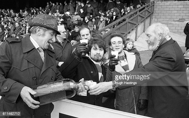 Chelsea Head Groundsman George Anstiss serves seasonal glass of whisky to the disabled fans at Stamford Bridge