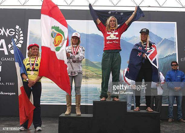 Chelsea Hedges celebrates her first place alongside of Pauline Ado of France Sofia Mulanovich of Peru and Paige Hareb of New Zealand in the podium of...