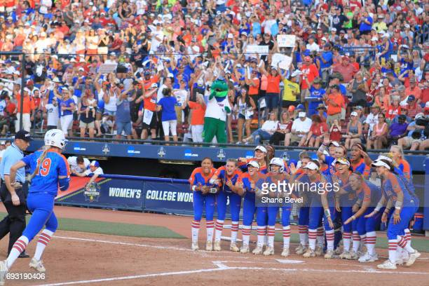 Chelsea Herndon of the University of Florida runs toward home plate as her team waits to celebrate with her as the Gators square off against the...