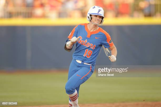 Chelsea Herndon of the University of Florida smiles as she rounds the bases against the University of Oklahoma during Game 2 of the Division I...