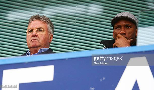 Chelsea interim manager Guus Hiddink and Didier Drogba of Montreal Impact are seen on the stand during the Barclays Premier League match between...