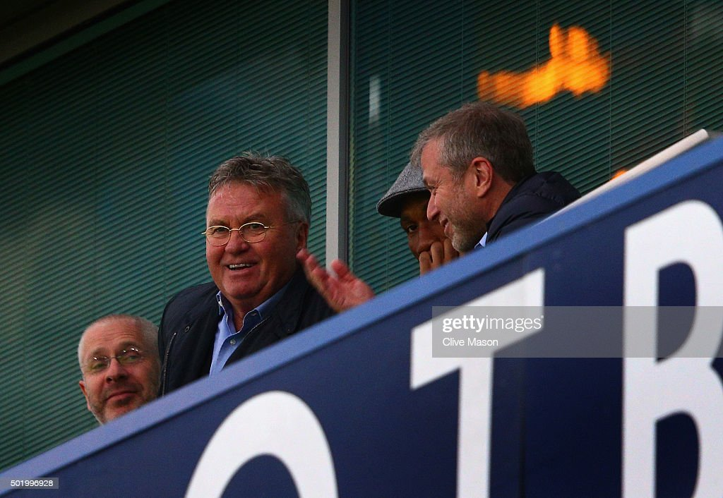 Chelsea interim manager Guus Hiddink (L), Didier Drogba (C) of Montreal Impact and Chelsea owner Roman Abramovich (R) are seen on the stand prior to the Barclays Premier League match between Chelsea and Sunderland at Stamford Bridge on December 19, 2015 in London, England.