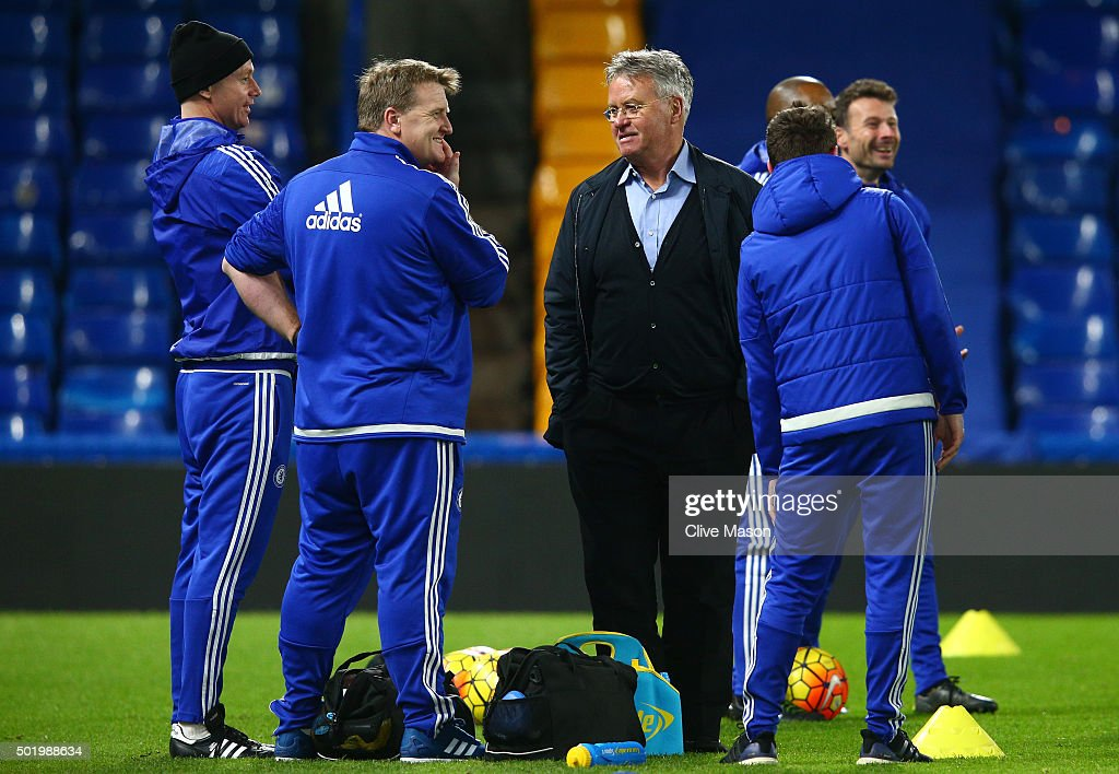 Chelsea interim manager Guus Hiddink (C) talks with staffs after their 3-1 win in the Barclays Premier League match between Chelsea and Sunderland at Stamford Bridge on December 19, 2015 in London, England.