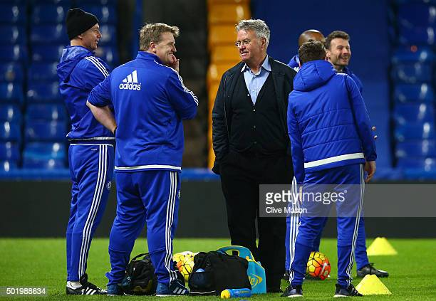 Chelsea interim manager Guus Hiddink talks with staffs after their 3-1 win in the Barclays Premier League match between Chelsea and Sunderland at...
