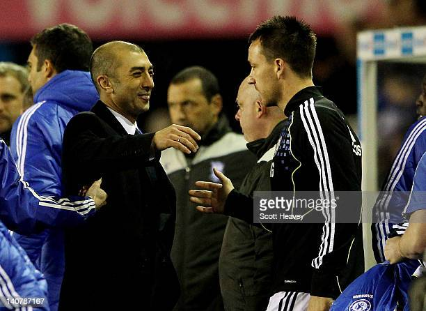 Chelsea interim manager Roberto Di Matteo celebrates with John Terry after the FA Cup Fifth Round Replay between Birmingham City and Chelsea at St...
