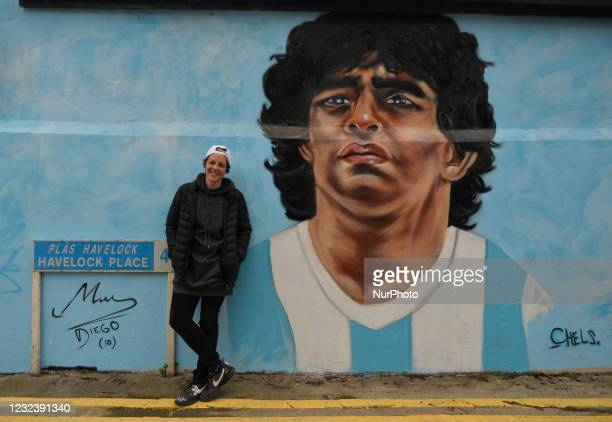 Chelsea Jacobs, an American artist living in Dublin), pictures in front of her new mural representing Diego Maradona, one of the greatest players in...