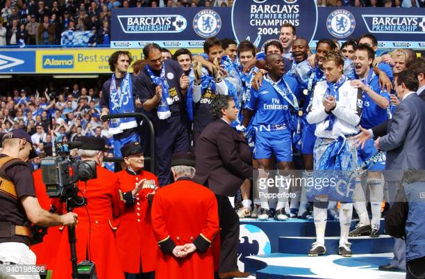 Chelsea Jose Mourinho joins his players on the podium following their FA Barclays Premiership title victory over Charlton Athletic at Stamford Bridge...