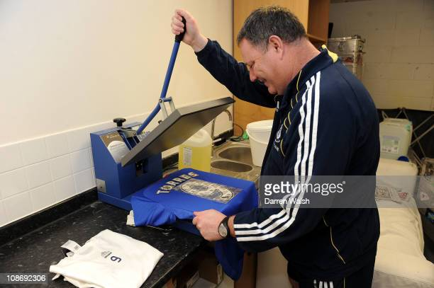 Chelsea Kit man Mick Roberts prints up the number 9 shirt for new signing Fernando Torres at Cobham training ground at Cobham on February 1 2011 in...