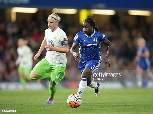 Chelsea Ladies Eniola Aluko takes on Nilla Fischer of Vfl Wolfsburg during UEFA Women Champion League Round of 32 match between Chelsea Ladies and...