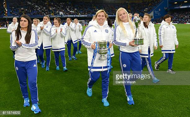 Chelsea Ladies on the pitch at half time following their victory at the FA Women's Super League