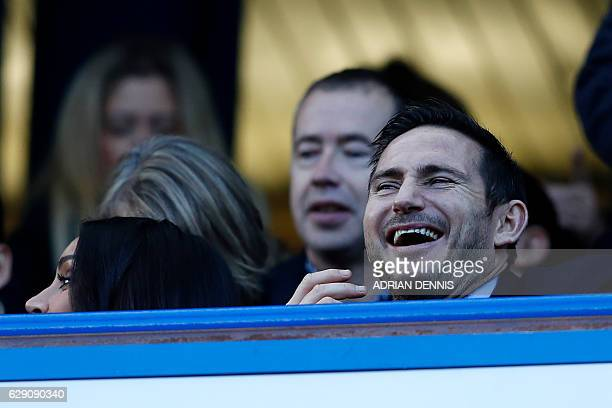 Chelsea legend Frank Lampard laughs as he awaits kickoff in the English Premier League football match between Chelsea and West Bromwich Albion at...