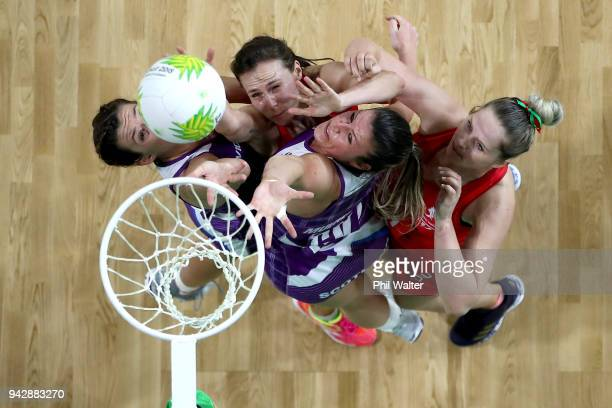Chelsea Lewis and Caralea Moseley of Wales and Hayley Mulheron and Fiona Isobel Fowler of Scotland contest the ball in the Netball match between...