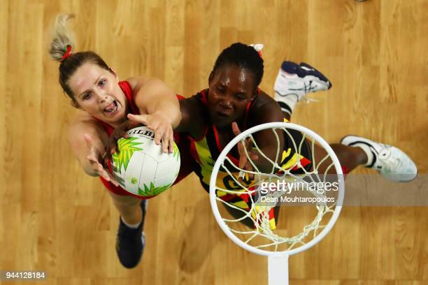 Chelsea Lewis of Wales and Ajio Lilian of Uganda battle for the ball during Netball on day six of the Gold Coast 2018 Commonwealth Games at Gold...