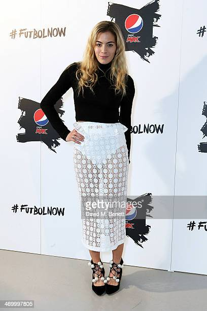 Chelsea Leyland attends Pepsi 'The Art of Football' Exhibition on February 17 2014 in London England