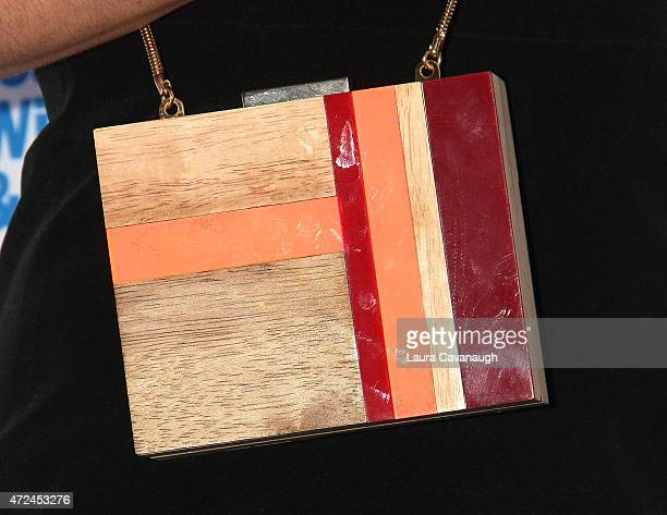 Chelsea Leyland purse detail attends The Doe Fund's sweet New York event at The Bowery Hotel on May 7 2015 in New York City