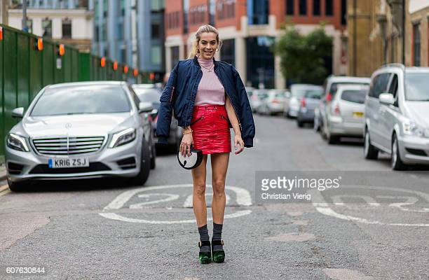 Chelsea Leyland wearing a bomber jacket and red skirt outside Topshop during London Fashion Week Spring/Summer collections 2017 on September 18 2016...