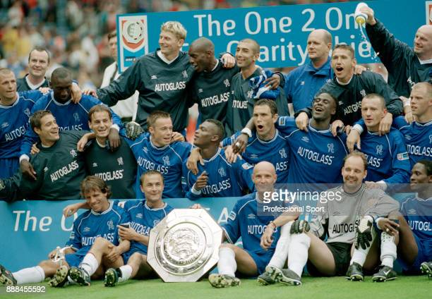 Chelsea line up for a group photo after winning the FA Charity Shield against Manchester United at Wembley Stadium on May 13 2000 in London England