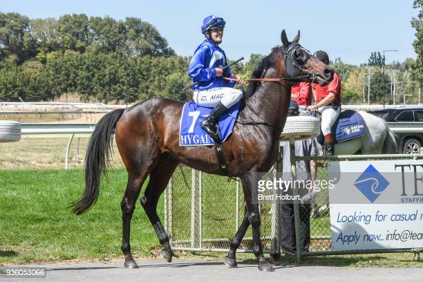 Chelsea MacFarlane returns to the mounting yard on Apocalypto after winning the Woodside Park Stud BM58 Handicap at Kyneton Racecourse on March 21...