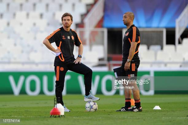 Chelsea manager Andre Villas Boas and assistant coach Roberto Di Matteo speak during a training session ahead of the UEFA Champions League Group E...