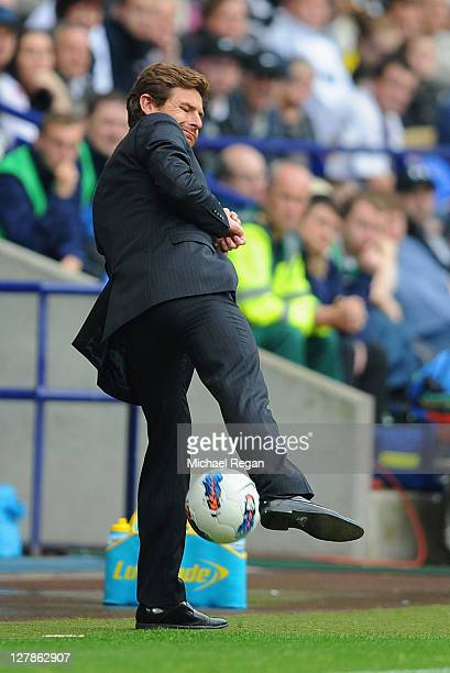 Chelsea manager Andre Villas Boas attempts to control the ball during the Barclays Premier League match between Bolton Wanderers and Chelsea at...