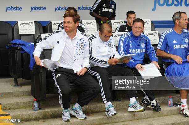 Chelsea Manager Andre VillasBoas and Assistant 1st team coaches Roberto Di Matteo and Steve Holland during a pre season friendly match between...