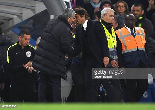 Chelsea manager Antonio Conte and Manchester United manager Jose Mourinho exchange words at the end of the Premier League match between Chelsea and...