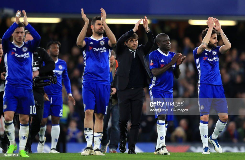 Chelsea manager Antonio Conte and players celebrate at full time during the Emirates FA Cup, Quarter Final match at Stamford Bridge, London.
