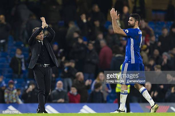Chelsea manager Antonio Conte applauds the fans with Diego Costa at full time of the Premier League match between Chelsea and Stoke City at Stamford...