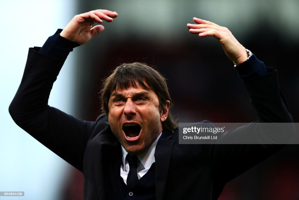 Chelsea manager Antonio Conte celebrates at full-time following the Premier League match between Stoke City and Chelsea at Bet365 Stadium on March 18, 2017 in Stoke on Trent, England.