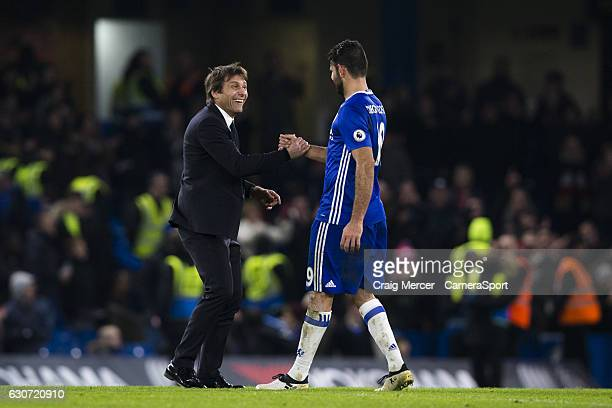 Chelsea manager Antonio Conte celebrates with Diego Costa at full time of the Premier League match between Chelsea and Stoke City at Stamford Bridge...